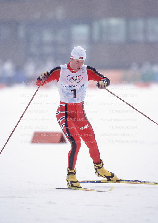 NAGANO, JAPAN  -  FEBRUARY 14:  Bjoern Daehlie #1 of Norway skis in the Men's 15 Kilometer Free Pursuit event of the Nordic Skiing competition at the 1998 Winter Olympics held on February 14, 1998 at the Snow Harp venue in Hakuba near Nagano, Japan.  Daehlie was the silver medalist in the event.  (Photo by David Madison/Getty Images)