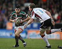 Photo: Rich Eaton.<br /> <br /> Leicester Tigers v Newcastle Falcons. Guinness Premiership. 27/01/2007. Frank Murphy of Leicester escapes the clutches of Falcons Russell Winter