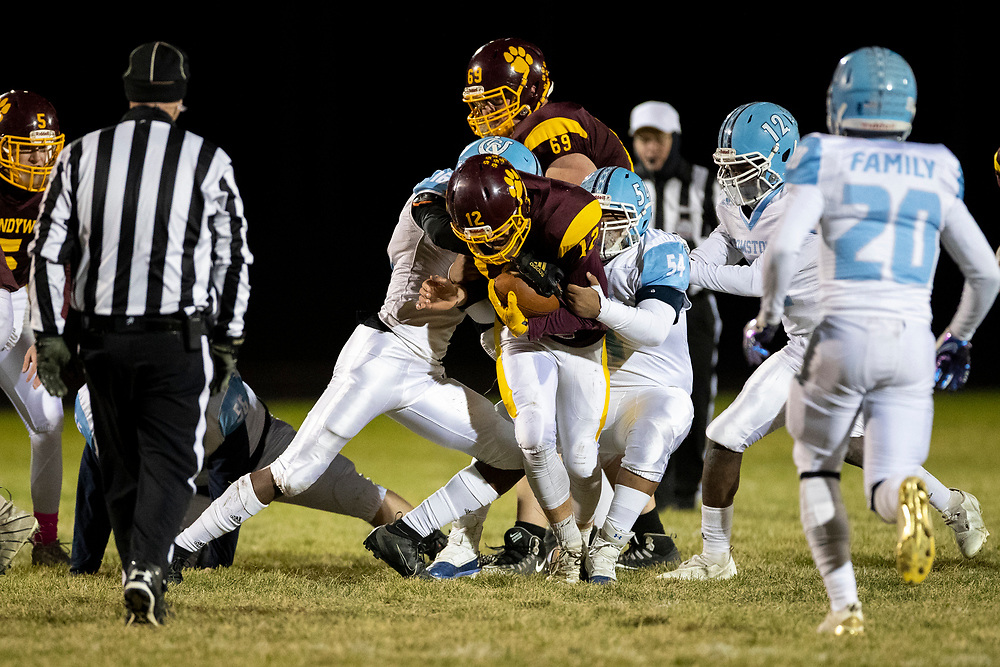Brandywine's Gabriel Gouin runs with the ball for a first down during the Comstock-Brandywine high school football game on Friday, October 30, 2020, at Selge Field in Niles, Michigan.