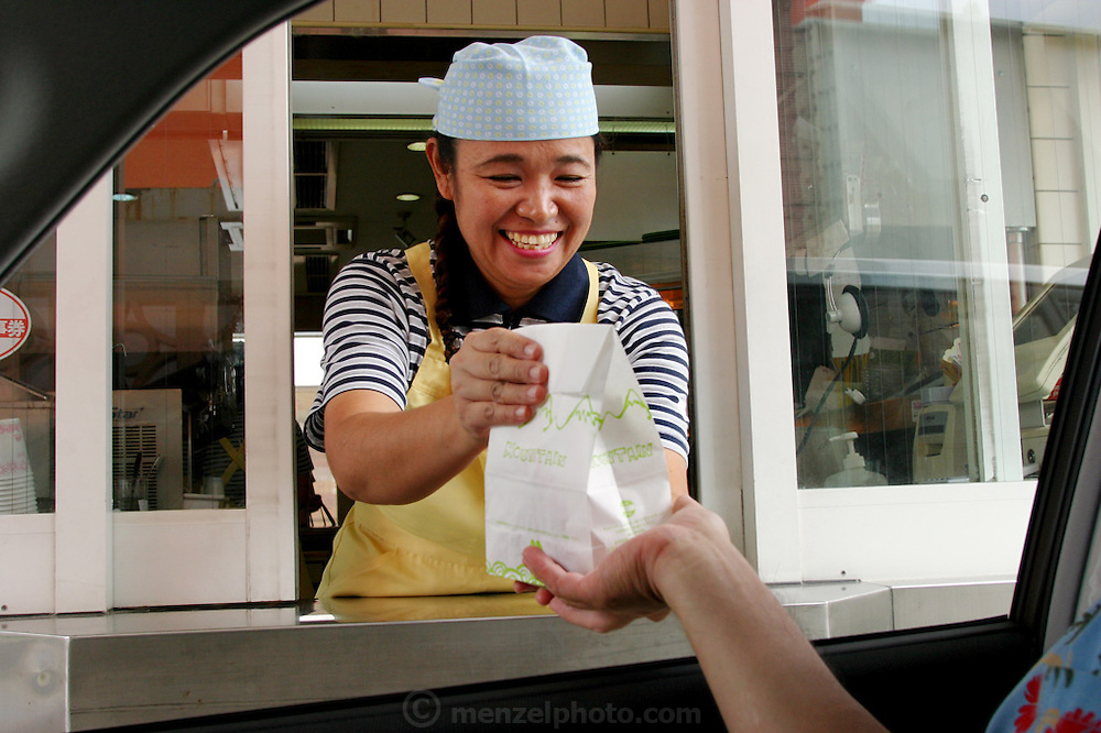 Mos Burger, a Japanese burger chain fast food restaurant car service window. (Supporting image from the project Hungry Planet: What the World Eats)