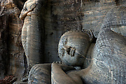 These two giant statues of Buddha in different states of contemplation have inspired pilgrims since being carved into the granite in the 12th century, Gal Vihara, Polonnaruwa.