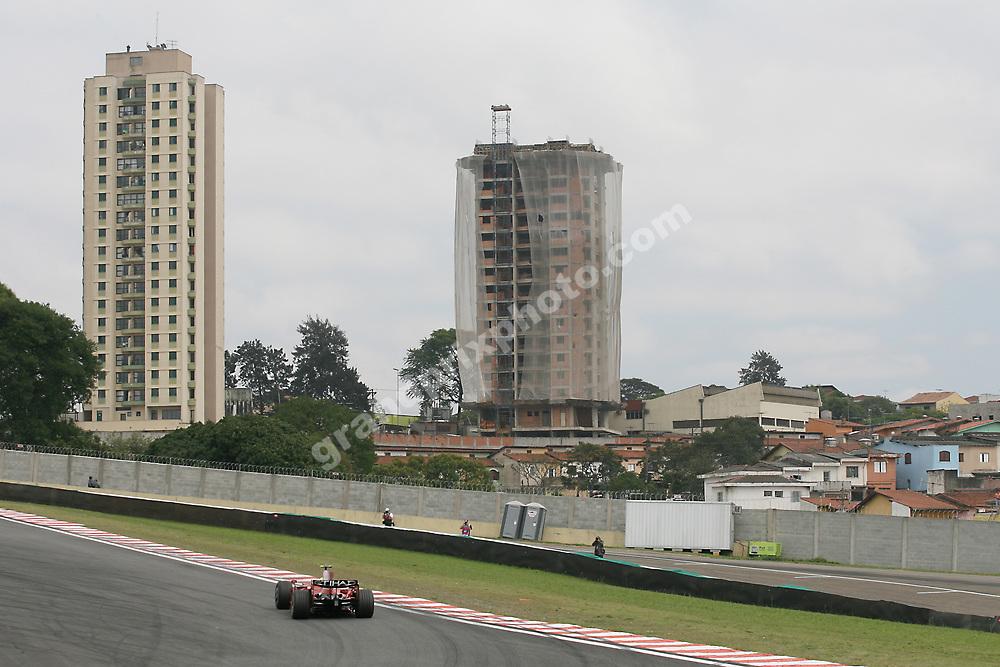 Felipe Massa (Ferrari) with buidings at the 2008 Brazilian Grand Prix at Interlagos in Sao Paulo. Photo: Grand Prix Photo
