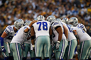 The Dallas Cowboys huddle in between plays against the Pittsburgh Steelers at Cowboys Stadium in Arlington, Texas, on December 16, 2012.  (Stan Olszewski/The Dallas Morning News)