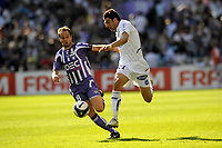 FOOTBALL - FRENCH CHAMPIONSHIP 2009/2010 - L1 - TOULOUSE FC v AJ AUXERRE - 25/04/2010 - PHOTO JEAN MARIE HERVIO / DPPI - DANIEL NICULAE (AJA) / ETIENNE DIDOT (TFC)