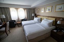 Bedroom in former cabin of Queen Elizabeth 2 former ocean liner now reopened as hotel in Dubai , United Arab Emirates