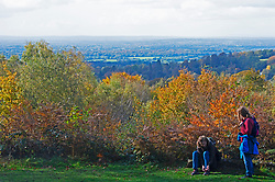 ©Licensed to London News Pictures 22/10/2020  <br /> Sevenoaks, UK. Two walkers stop for a break with a view across Kent. The calm after storm Barbara today with bright autumnal colours at Toys Hill woodland in Sevenoaks, Kent.  Photo credit:Grant Falvey/LNP