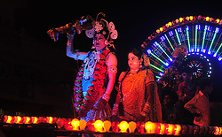 September 26, 2016 - Allahabad, Uttar Pradesh, India - Allahabad: Artist dressed as Lord Shiva and Goddess Parwati performs during a religious procession Ravan ki Barat in Allahabad on September 26, 2016, held to mark the Dussehra festival. The name Dussehra is derived from Sanskrit Dasha-hara literally means removal of ten referring to Lord Rama's victory over the ten-headed demon king Ravana. Dussehra is celebrated on the tenth day of the month of Ashwin according to the Hindu calendar which corresponds to September or October of the Gregorian calendar. (Credit Image: © Prabhat Kumar Verma via ZUMA Wire)