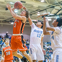 Artesia Bulldog Cody Smith (3), left, is blocked from behind by Window Rock Scout Adrian Destea (12) during the Bengal Boys Basketball Invitational Tournament at Gallup High School Friday.