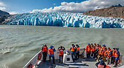 Lago Grey Ferry, Torres del Paine National Park. Puerto Natales, Chile, Patagonia, South America. Grey Glacier has receded 4 km and lost 17 square kilometers from the mid 1900s through 2010.  Torres del Paine National Park is listed as a World Biosphere Reserve by UNESCO. This image was stitched from multiple overlapping photos.