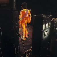 Jimi Hendrix -.Jimi Who? .- Jimi cuts a lonely figure in the dark of the night, surrounded by speakers and equipment. Who would think from this image that 600,000 people were just out of shot with all eyes on him? Had Hendrix borrowed those speakers, or was he just looking after them?