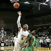 Central Florida guard Marcus Jordan (5) draws a fouls against Marshall guard Johnny Higgins (4) during a Conference USA NCAA basketball game between the Marshall Thundering Herd and the Central Florida Knights at the UCF Arena on January 5, 2011 in Orlando, Florida. Central Florida won the game 65-58 and extended their record to 14-0.  (AP Photo/Alex Menendez)