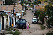 TEGUCIGALPA, HONDURAS - NOVEMBER 14, 2013: A woman walks by the streets of Flor del Campo neighborhood, one of the most violent neighborhoods of Tegucigalpa. The current government has created the Military Police to struggle against the criminality that batters Honduras. CREDIT: Rodrigo Cruz for The New York Times