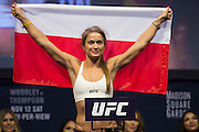 Karolina Kowalkiewicz steps on the scale during the UFC 205 weigh-ins at Madison Square Garden in New York, New York on November 11, 2016.  (Cooper Neill for The Players Tribune)