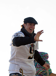 09 February 2010. New Orleans, Louisiana, USA. <br /> Drew Brees leads the team as Saints Mania captures New Orleans like no other parade. The New Orleans Saints victorous NFL football team makes its way from the Superdome through the city. Drew Brees and the crew make their way through screaming fans. The team salutes the massed crowds along the victory parade route in downtown New Orleans following the team's stunning victory over the Indianapolis Colts for Superbowl 44. <br /> Photo ©; Charlie Varley. Varleypix.com