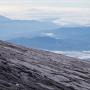 Hikers near the summit on Kinabalu Summit Trail, Kinabalu National Park, Borneo, Malaysia.