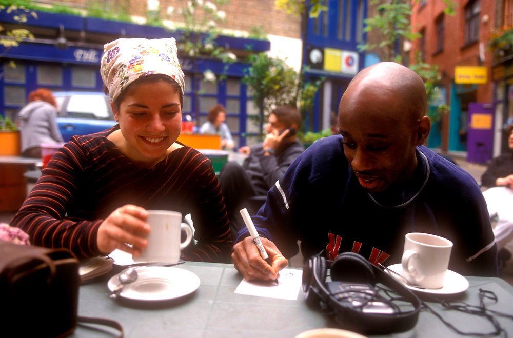 Neal's Yard Covent Garden couple chatting over coffee,