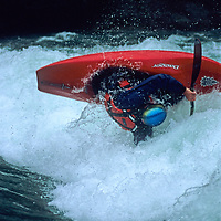 KAYAKING. Boater (MR) on Kananaskis River, Rocky Mountains, Alberta, Canada.