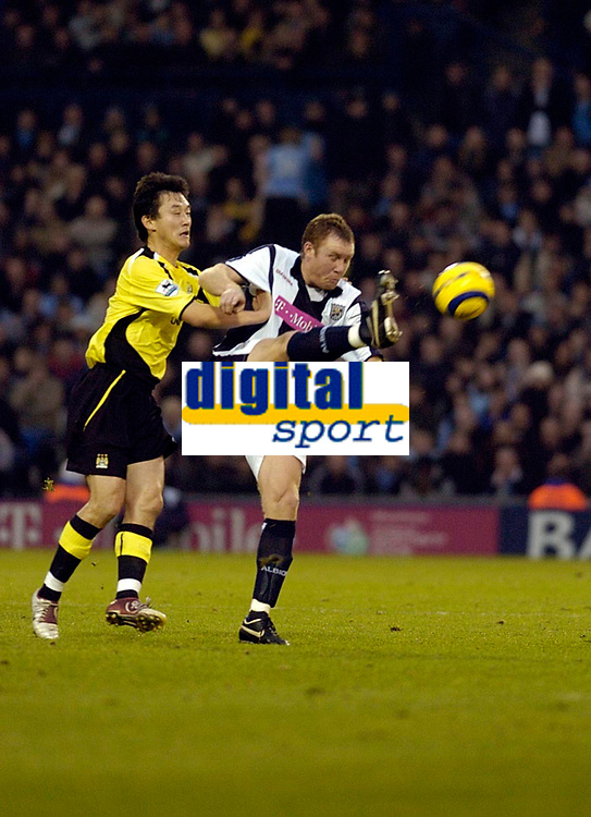 Photo: Leigh Quinnell.<br /> West Bromwich Albion v Manchester City. The Barclays Premiership. 10/12/2005. Man Citys Jihai Sun clashes with West Broms Steve Watson on the ball.