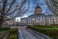 The inner courtyard gardens of the Salt Lake City Utah Capitol building during early Spring at dusk.  The lights come on and the sun sets off to the West.