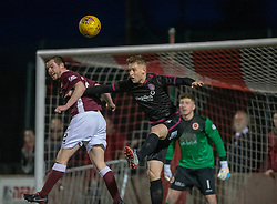 Stenhousemuir's Alan Reid and Arbroath's Thomas O'Brien. Stenhousemuir 1 v 4 Arbroath, Scottish Football League Division One play12/1/2019 at Ochilview Park.