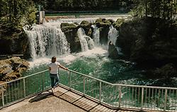 THEMENBILD - eine Frau sthet auf der Aussichtsplatform vor dem Traunfall und seinem Fluss. aufgenommen am 24. April 2019 in Steyrermühl, Oesterreich // a woman standing on the viewing platform in front of the Traunfall and the river in  Steyrermuehl, Austria on 2019/04/24. EXPA Pictures © 2019, PhotoCredit: EXPA/ JFK