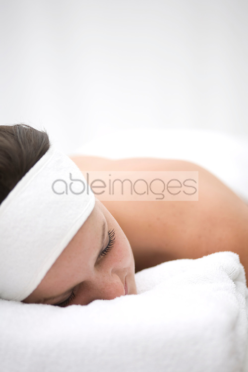 Close up of young woman lying on stomach and relaxing after beauty treatment