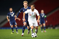 Scotland's Callum McGregor (left) and Portugal's Kevin Rodrigues battle for the ball during the International Friendly match at Hampden Park, Glasgow.
