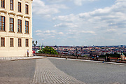 "Mostly Czech citizens visiting empty ""Hradcany Square"" (Hradcanske Namesti) towards the panoramic view at the Prague cityscape. On the left Prague Castle. The Czech government lowered the security measures and as of Monday 25 May 2020, wearing of protective masks will be mandatory only in the interiors of buildings other than the place of residence and in public transport."
