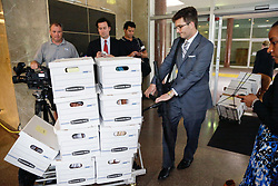 12 June  2015. New Orleans, Louisiana. <br /> Lawyers leave Civil District Court weighed down with papers for the last day of the hearing to determine whether Tom Benson, billionaire owner of the NFL New Orleans Saints, the NBA New Orleans Pelicans, various auto dealerships, banks, property assets and a slew of business interests remains capable of managing his own business empire. Benson changed his succession plans and  decided to leave the bulk of his estate to third wife Gayle, sparking a controversial fight over control of the Benson business empire.<br /> Photo©; Charlie Varley/varleypix.com