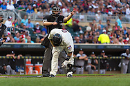 Home plate umpire Cory Blaser signals Brian Dozier #2 of the Minnesota Twins to take 1st base after Dozier was hit by a pitch against the Chicago White Sox on June 19, 2013 at Target Field in Minneapolis, Minnesota.  The Twins defeated the White Sox 7 to 4.  Photo: Ben Krause