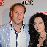 NLD/Blaricum/20111120 - Benefietdiner St. Stop Kindermisbruik, Arjan Erkel en partner