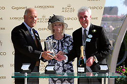Owner Jeffrey Smith is presented with his trophy after winning the Duke of Edinburgh Stakes with Dash of Spice during day four of Royal Ascot at Ascot Racecourse
