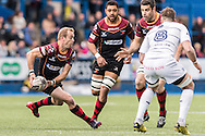 Sarel Pretorius of the Newport Gwent Dragons (L) gets ready to pass the ball as Josh Turnbull  of the Cardiff Blues (R) closes him down. Guinness Pro12 rugby match, Cardiff Blues v Newport Gwent Dragons at the Cardiff Arms Park in Cardiff, South Wales on Sunday 17th April 2016.<br /> pic by Simon Latham, Andrew Orchard sports photography.