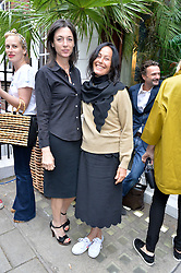 Left to right, MARY MCCARTNEY and AMANDA HARLECH at the launch of the new collection from Limoland held at Anderson & Sheppard's Haberdashery, 17 Clifford Street,London on 16th June 2014.