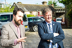 Pictured: Josiah Lockhart and Keith Brown<br /> <br /> Cabinet Secretary for Economy, Jobs & Fair Work Keith Brown visited Gorgie City Farm today  to mark their accreditation as the 800th Living Wage employer in Scotland. Mr Brown met Josiah Lockhart, CEO and undertook a short tour of the farm, celebrating their accreditation and promoting the Living Wage more generally. The Scottish Government has set a target of reaching 1,000 Scottish-based Living Wage Accredited Employers by autumn 2017. While at the farm Mr Brown met Maia Gordon, Kirsty McGoff (17) and Zoe White (18), who have benefited from the living wage, and George Ellis, chair of the farm's board of directors<br /> Ger Harley   EEm 18 May 2017