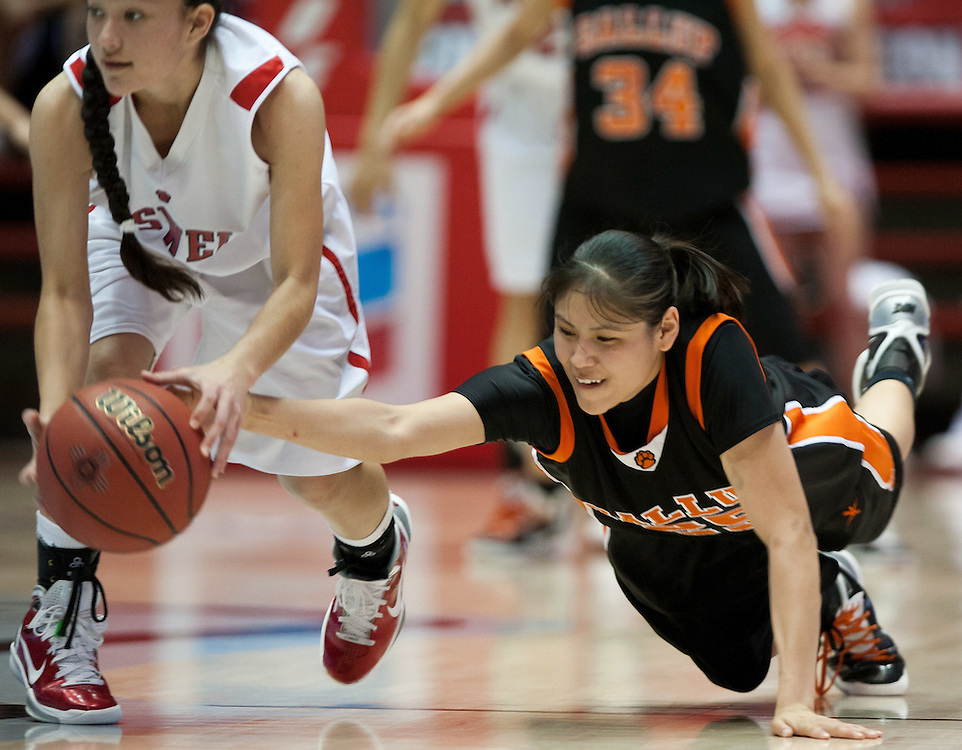 Gallup's Stacy Charley dives trying to steal the ball from Roswell's Arianna Gomez. Gallup defeated Roswell 50-44 in the AAAA semifinals Thursday morning in Albuquerque at The Pit.