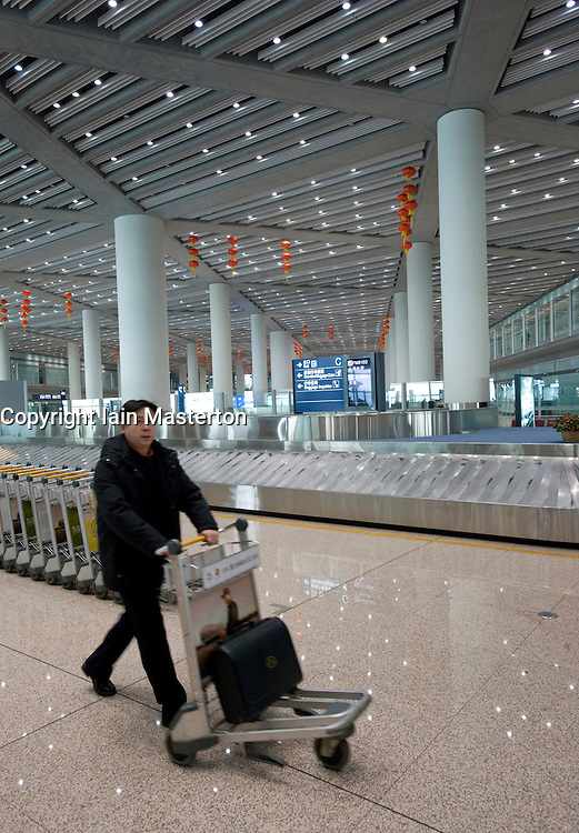 Interior view of huge baggage reclaim hall at the new Terminal 3 in Beijing International Airport designed by Sir Norman Foster China 2009