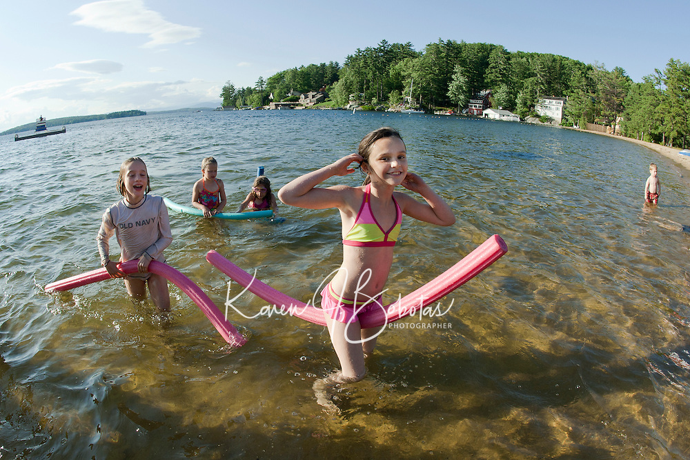 "Cyndal Vansteensburg, Sydni Lehr, Abby Jarvi and Seanna Langley partake in ""noodle"" races at Gilford Beach during the Kick Off to Summer event put on by Gilford Parks and Recreation Wednesday evening.  (Karen Bobotas/for the Laconia Daily Sun)Gilford Parks and Recreation Summer Kick Off Party at Gilford Beach June 29, 2011."