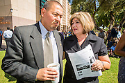 25 JUNE 2012 - PHOENIX, AZ:  State Sen. STEVE GALLARDO, left, and Maricopa County Supervisor MARY ROSE WILCOX, discuss the US Supreme's Court's decision overturning most of SB1070, Arizona's tough anti-immigration bill. Both people, long time civil rights activists in Arizona, were opposed to the law. The case, US v. Arizona, determined whether or not Arizona's tough anti-immigration law, popularly known as SB1070 was constitutional. The court struck down most of the law but left one section standing, the section authorizing local police agencies to check the immigration status of people they come into contact with.      PHOTO BY JACK KURTZ
