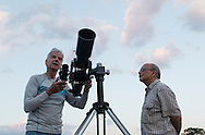Middletown, New York - SUNY Orange professor Kevin McGee, left, sets up a 4-inch refractor telescope before an astronomy program on viewing constellations and planets on the Green Patio of the Rowley Center for Science and Engineering on the Middletown campus on May 12, 2015. The program was run by SUNY Orange adjunct assistant professor Tom Blon and sponsored by SUNY Orange Cultural Affairs.
