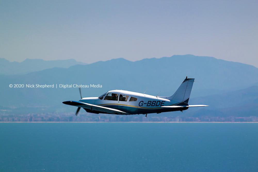 Light aircraft, Piper Arrow II, tracking the Spanish coastline near Denia in Spain, flying over the Mediterranean Sea.