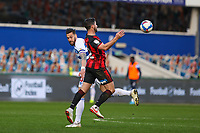 Football - 2020 / 2021 Sky Bet Championship - Queens Park Rangers vs AFC Bournemouth - Kiyan Prince Foundation Stadium<br /> <br /> Shane Long (AFC Bournemouth) chests the ball ahead of the turning Geoff Cameron (Queens Park Rangers) <br /> <br /> COLORSPORT/DANIEL BEARHAM