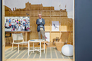 A Place Called Home' London design festival Trafalgar Square - brings together four highly acclaimed designers who have been invited to create their own interpretation of home. The four designers, Jasper Morrison (pigeon fanciers room - pictured with teh designer), Patternity, Raw Edges and Studioilse present a personal vision. The four 'homes' appear to be similar in construction from the outside though each will have its own individual exterior identity, hinting at the creative interiors which range from a room which expands and contracts to the home of a pigeon fancier. This is the Landmark project for  the London Design Festival and is in collaboration with Airnb. Trafalgar Square, London UK, 18 Sept 2014.
