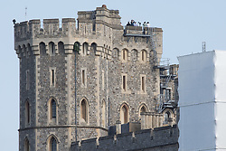 Windsor, UK. 13th June, 2021. Police officers and officials watch from a tower above Windsor Castle shortly before the visit of President Biden. President Biden and First Lady Jill Biden were welcomed at Windsor Castle by the Queen following the G7 summit with a Guard of Honour followed by afternoon tea.