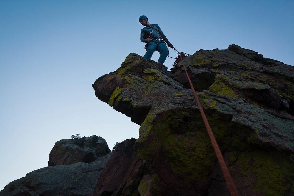 Obadiah Reid belays the photographer up Calypso (5.6) on Wind Tower, Eldorado Canyon State Park, Colorado.