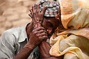 30th May 2014, Ushait, India. Sohan Lal (55) father of raped and murdered daughter teenager Murti (11 or 12) weeps and is comforted by his mother Ramkali in Katra Sadatganj village,Ushait near Baduan, Uttar Pradesh, India on the 30th May 2014.<br /> <br /> Two teenage girls, low-caste cousins Murti (11-12) and Pushpa (13-14) were allegedlygang-raped and murdered with their bodies found hanging from a mango tree in Katra Sadatganj village on the morning of Thursday the 29th May. The two girls, who were cousins and aged between 11 and years, went missing from their house the previous night.The incident triggered protests in the area with villagers alleging police apathy following which an FIR was registered against seven persons including constables Sarvesh Yadav and Rakshapal Yadav, who were suspended.<br /> <br /> PHOTOGRAPH BY AND COPYRIGHT OF SIMON DE TREY-WHITE<br /> + 91 98103 99809<br /> email: simon@simondetreywhite.com photographer in delhi photographer in delhi photographer in delhi