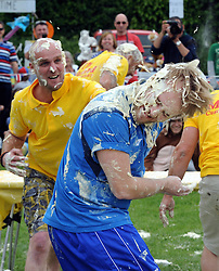 © Licensed to London News Pictures. 31/05/2014<br /> Luke Baker in Blue from Team Baker Boys gets a pie in the face by a member of Mustard Custard Chuckerz (yellow)<br /> World Custard Pie Championships at Coxheath Heath Village,Coxheath,Kent.<br /> Photo credit :Grant Falvey/LNP