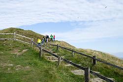 Visitors to the Peak National Park walk down the paved and stepped western side of Mam Tor in Castleton <br />  11 October 2015<br />   Image © Paul David Drabble <br />   www.pauldaviddrabble.co.uk