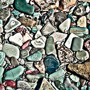 water worn colorful lake rocks glacier national park
