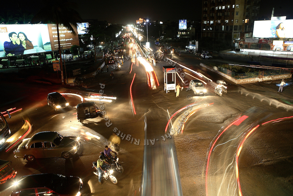 Vehicles are passing by the busy Jaydev Bihar crossing on Friday, May 16, 2008, in Bhubaneswar, the capital of Orissa State. **Italy and China Out**